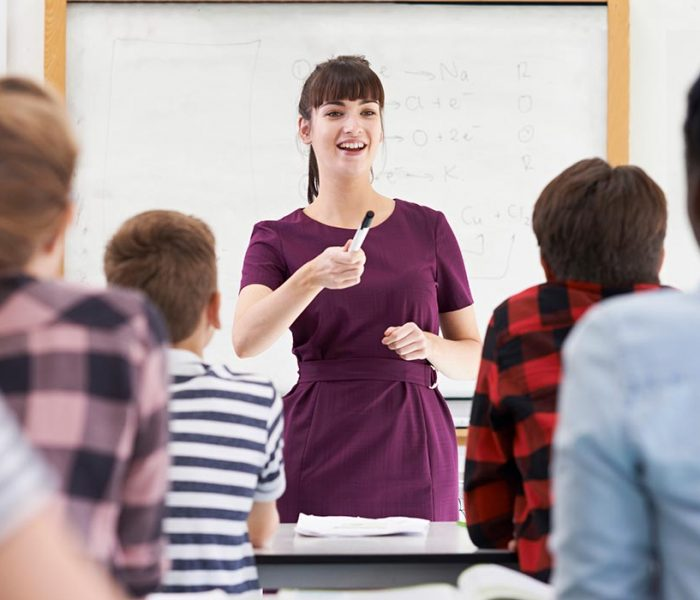 Enthusiastic Teacher With Class Of Teenage Students
